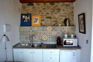 A kitchen or kitchenette at Almanzora Apartments