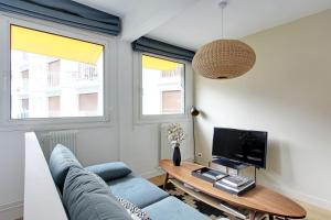 A television and/or entertainment center at Pick a Flat - Eiffel Tower / Champs de Mars apartments