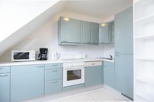 A kitchen or kitchenette at Vienna-apartment-one Mariannengasse