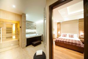 Krevet ili kreveti u jedinici u okviru objekta NV Luxury Suites & Spa
