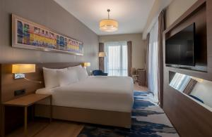 A bed or beds in a room at Radisson Blu Residence, Istanbul Batisehir