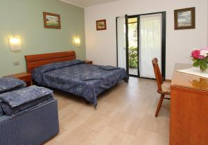 A bed or beds in a room at Eurobeach Residence