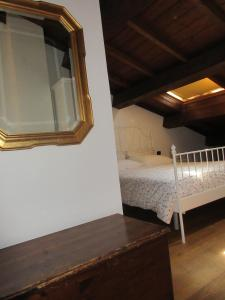 A bed or beds in a room at Appartamento Verona