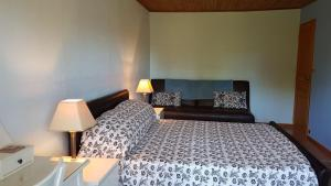 A bed or beds in a room at Les Papillons