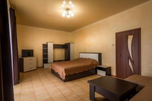 A bed or beds in a room at Квартира в курортной зоне