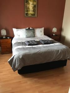 Cama o camas de una habitación en Jadan Cottages
