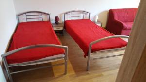 Ein Bett oder Betten in einem Zimmer der Unterkunft Ferienwohnug Maya