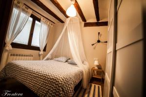 Cama o camas de una habitación en La Casa del Tio Gato