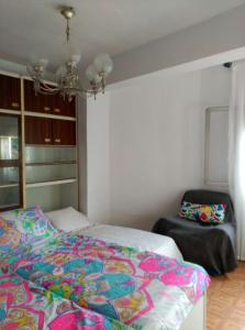 A bed or beds in a room at Apartamento Carabanchel Castizo