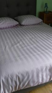 Un ou plusieurs lits dans un hébergement de l'établissement Appartement Saint-Amour