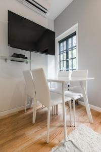 A television and/or entertainment center at Prime location in West Village 1 bedroom with 2 baths