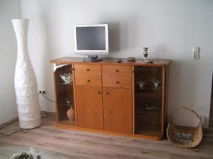 A television and/or entertainment center at Ferienhaus Zum Amthof