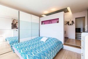 Un ou plusieurs lits dans un hébergement de l'établissement Maison de Vacances Paradis