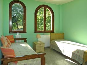 Łóżko lub łóżka w pokoju w obiekcie Ferienwohnung Finale Ligure 285S