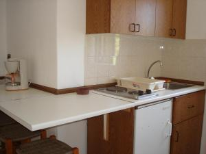 A kitchen or kitchenette at Popi Hotel Apartments