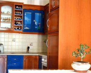 A kitchen or kitchenette at Saga Hotel