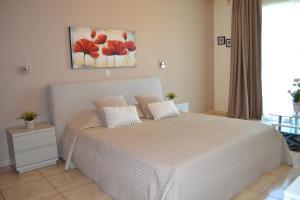 Un ou plusieurs lits dans un hébergement de l'établissement Marianna Hotel Apartments