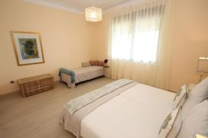A bed or beds in a room at Villa Apartments Amagante