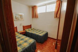 A bed or beds in a room at Servatur Barbados