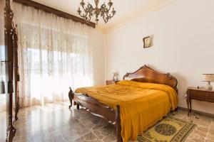 A bed or beds in a room at Casa Nina
