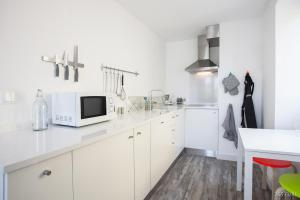 A kitchen or kitchenette at Zona Velha Apartments by Travel to Madeira