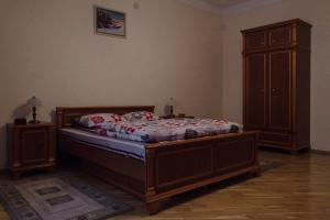 A bed or beds in a room at Apartments in the Historical Centre - Lviv