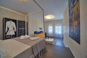 A bed or beds in a room at AMOsuites & Spa