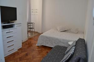 A bed or beds in a room at Studio Copacabana