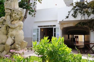 Hostal Oasis Menorca fotografía