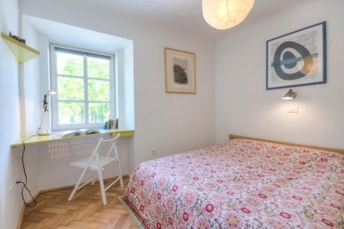 A bed or beds in a room at Apartment Studentovska
