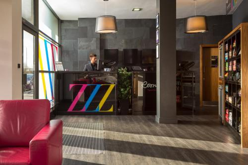 The lobby or reception area at Roomzzz Leeds City West