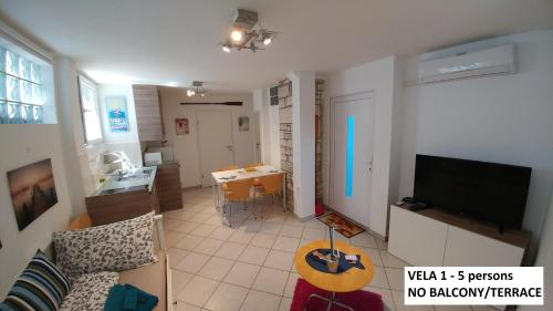 A television and/or entertainment center at Apartments Vela