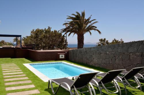 The swimming pool at or near Villa Lobos