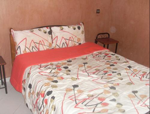 A bed or beds in a room at Appartement Résidence Mixta