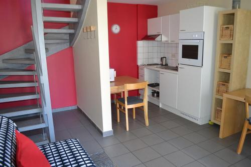 A kitchen or kitchenette at Appart'hotel City Mons Centre