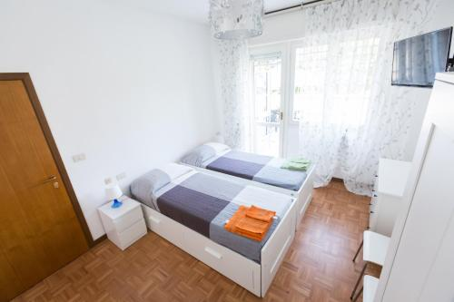 A bed or beds in a room at Bolognina Central Apartment