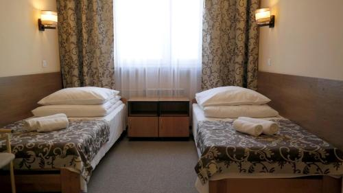 A bed or beds in a room at Ośrodek SCSK Optima