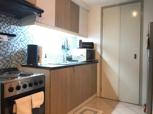 A kitchen or kitchenette at Corner BGC Suite @Parklane