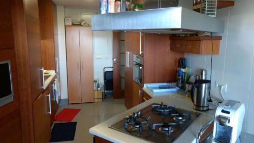A kitchen or kitchenette at Miriam Sousa