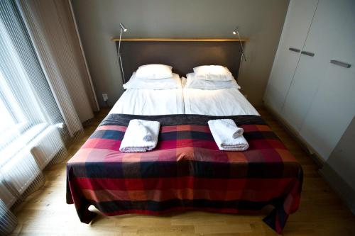 A bed or beds in a room at Levi Suites Levin Klubi