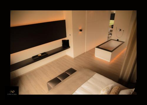 A bed or beds in a room at Lemniscape Amoras Luxury Suite