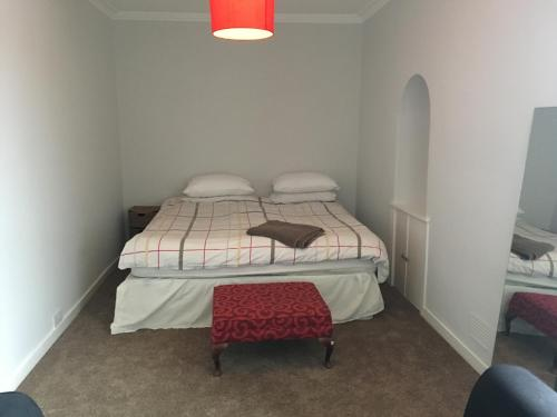 A bed or beds in a room at Kings Seat