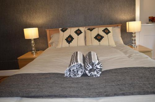 A bed or beds in a room at Darly Appartment