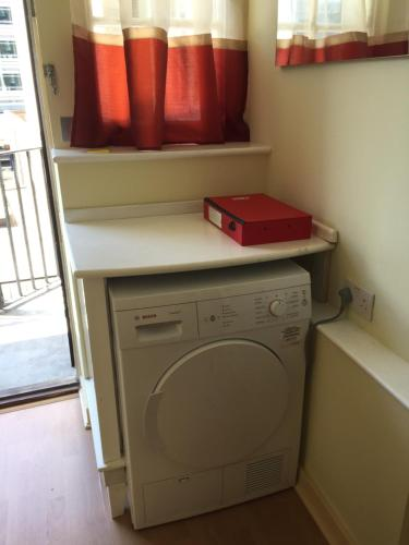 A kitchen or kitchenette at Flat2C The former fire station