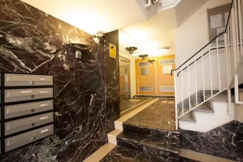 A bathroom at Fitzrovia Apartments by Allô Housing