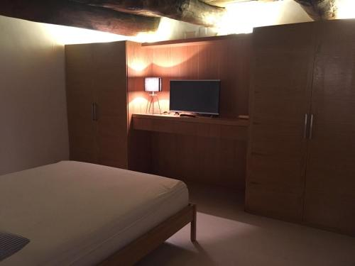 A television and/or entertainment center at loft in PALAZZO TRINA 1600d.c.