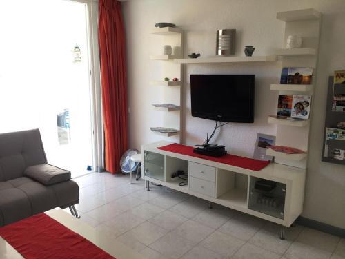 Een TV en/of entertainmentcenter bij Apart Hotel Ponderosa