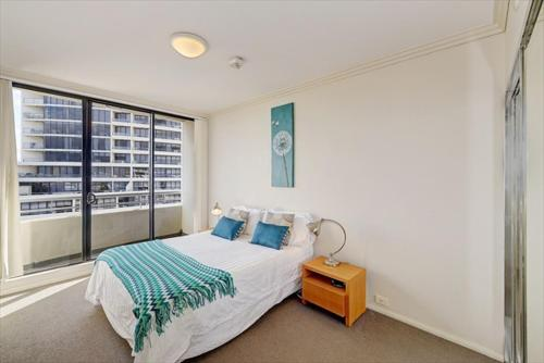 A bed or beds in a room at Apartment Sergeants Lane(F1602)