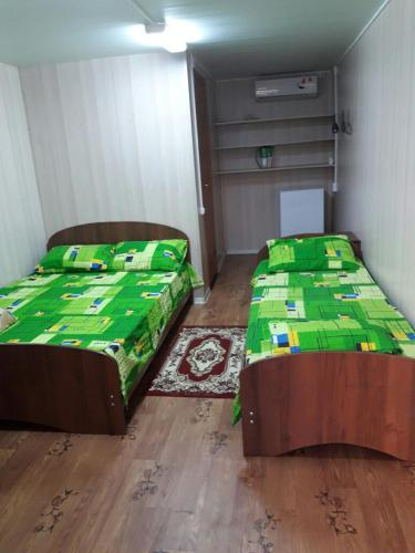 Кровать или кровати в номере Guest house on Krymskaya 20