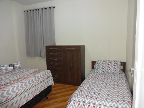 A bed or beds in a room at Apartamento São Vicente